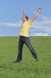 Jump. Ing man enjoying outdoor recreation Stock Photo