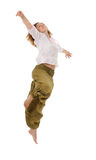Jump. Dancing woman making a free dance jump Stock Photography