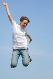 Jump. Young girl jump against a blue sky Royalty Free Stock Photos