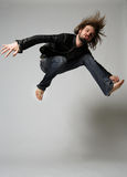 Jump. Ing man with mad face Royalty Free Stock Images