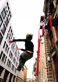 Jump. Acrobat in the streets of Old Montreal Stock Images