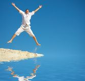 Jump. A man jumping into the air and spreading his arms and legs Stock Photography