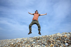 Jump. Man jumping on sand stones Royalty Free Stock Photos