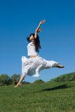 Jump. In a white dress Stock Photo