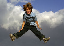 Jump. Happy smiling boy jumping children Stock Image