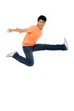 Jump. 1 Asian man jumping up in the air Royalty Free Stock Photo