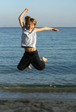Jump. Happy young boy jumping for joy Royalty Free Stock Image