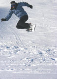 Jump. Snowboarder jumping stock image