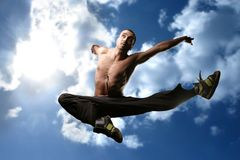 Jump. A young athletic rapper jump Stock Images