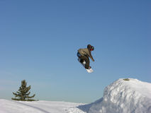 Jump. Ing snowboarder stock image