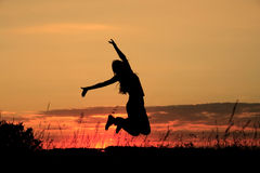 Jump. Dark silhouette of the jumping girl on a background Royalty Free Stock Photo