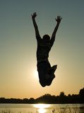 Jump. Young guy in jump on background dark sky royalty free stock image