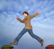 Jump!. Boy (7) taking a giant leap through the air on a playground Stock Photography