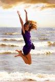 Jump. The girl on coast of a gulf Royalty Free Stock Photos