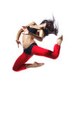 Jump. Young and beautiful dancer jump on isolated background Royalty Free Stock Images