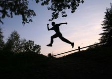 Jump. Silhouette of a man outdoors running and jumping Royalty Free Stock Photos