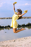 Jump. The girl frolic on the beach Royalty Free Stock Images