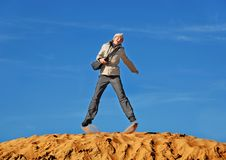 In a jump. Jump on sand, on a background of the sky Royalty Free Stock Photography