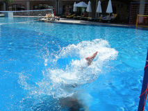 Jump. Man jumping into the pool royalty free stock photography