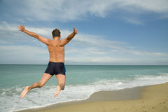 Jump against the sea Royalty Free Stock Photo