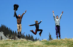 Jump in air. Photo of a happy peoples . jump over a grass field on mountain, freedom feel stock photos