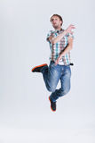 Jump around. Young man jumping on a clear background Royalty Free Stock Image