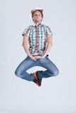 Jump around. Young man jumping on a clear background Royalty Free Stock Images