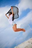 Jump on the beach. Girl enjoys fresh breeze on the beach Royalty Free Stock Photography