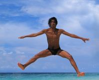 Jump on beach. Dance jump (cheer dancing) of Asian male on tropical beach Stock Images