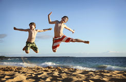 Jump at the beach Stock Images