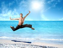 Jump on the beach. A man jump on the beach Royalty Free Stock Photography