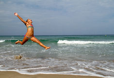Jump on the beach Royalty Free Stock Image