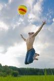 Jump behind a ball. Stock Photo