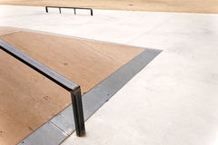 Jump box with rail in an empty skate park. Royalty Free Stock Photography