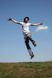 Jump boy on meadoww Royalty Free Stock Photo