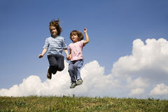 Jump of children and the sky Stock Photos