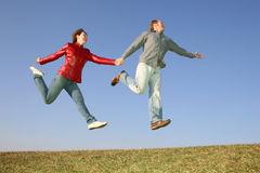 Jump couple Stock Photography