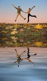 Jump couple. autumn water Royalty Free Stock Photo