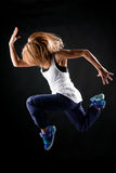 Jump in dance. Girl is jumping over black Stock Photo