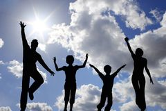 Jump family of four on sky. Jump family of four on blue sky royalty free stock photo