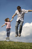 Jump of father and child Royalty Free Stock Photo