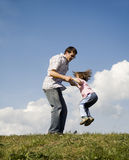 Jump of father and child Royalty Free Stock Images