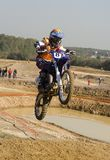 Jump at finish line. Young motocross rider jumping at finish line Stock Image