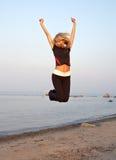 Jump. Fit girl jumping at the seashore Royalty Free Stock Photos