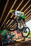 Jump and fly on a mountain bike in forest Stock Photo