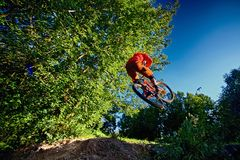 Jump and fly on a mountain bike. Stock Photography