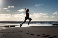 Jump. Flying fitness girl Royalty Free Stock Photos