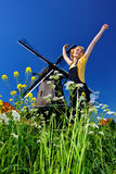 Jump of freedom. Windmill on the back Stock Photography