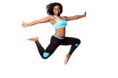 Jump for freedom. Beautiful happy energetic woman doing freedom sports jum with arms open, isolated Stock Photos