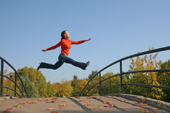 Jump girl Stock Images